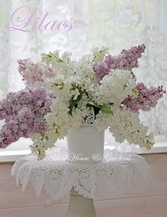 Lilacs in a white vase.