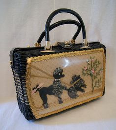 Chic 1950's black woven handbag with lucite trim by wearitagain, $225.00