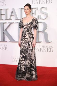 For the most recent premiere, Johnson ventured outside her comfort zone. The sea creature-patterned Alexander McQueen gown features poofy, princess sleeves and a wide neckline. Dakota Johnson in Alexander McQueen at the premiere of 50 Shades Darker in London, England, February 2017.  Mike Marsland/Getty Images