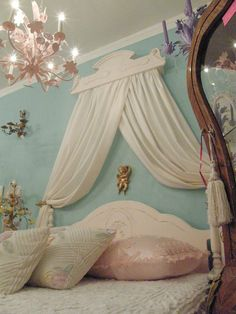 Hate the angel and how the drapes are pulled back, but love the idea of using an old crown piece for above the bed.