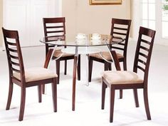 5 pc metal and glass dining table set with wood trim legs and wood chairs