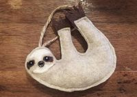 This little sloth is sure to make you smile! These slow moving creatures are usually found in the rainforest, but you can invite this little guy into your home. He is made from felt and stuffed with soft cotton for cuddling. #ad