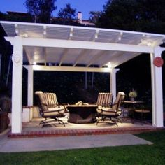 Free Standing Patio Cover Idea With White Painted Pillars And Aluminum Roof