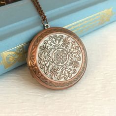 Large Rose Gold Locket Necklace, embossed filigree vintage style... ($30) ❤ liked on Polyvore featuring jewelry, pendant jewelry, rose gold pendant, filigree locket, antique jewellery and medallion jewelry
