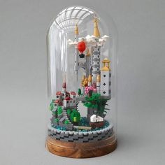 AWESOME!!! What else could you say about this absolutely marvelous creation from Peter Ilmrud. Look at all the details. The clouds in the sky and the air-balloon that seems to fly free in the sky. And everything fits in a glas dome from IKEA.  #lego #legos #legomoc #moc #instalego #legostagram #afol #legophotography #legoart #legophoto #legomania #brixtar  #microscale #ikea by brixtar_official