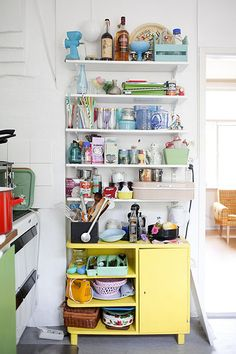 Colorful kitchen shelves.
