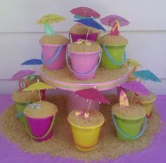 """Beach Party Cake - I made this for my nieces beach birthday party.  I used real beach pails and filled the top half with cake.  Then graham cracker """"sand"""" and finished each with either a pair of flip flops or a surfboard...both made from fondant.  The kids all loved getting their own cake to eat!  Fun and easy to do!"""