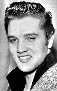 Taken at the Warwick Hotel in New York City on Sunday, January 6, 1957. Before his third and final appearance on the Ed Sullivan show that night Elvis met with six or seven-year-old Joanne Wilson, the 1956 March of Dimes poster girl and did some PR in the fight against cancer.