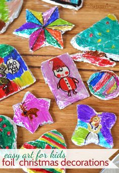 * make easy foil christmas decorations -- need: shapes cut from cardboard, aluminum foil, permanent markers, possibly a dab of glue, & ribbon or yarn for hanging