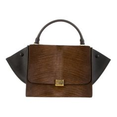 Céline Trapeze Bag (100,845 MKD) ❤ liked on Polyvore featuring bags, handbags, celine, calf hair handbag, top handle bag, fold over purse, calf hair purse and trapeze bag
