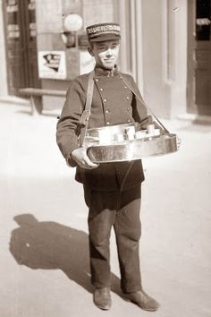 Old Picture .early 1900. Young man selling candy. He is working the train station.