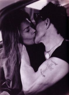 Mickey Rourke and Carre Otis (once husband and wife)