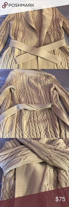 """Beige Sweater Tommy Hilfiger sweater in excellent condition. Wore this one time, heavy in weight. I don't know how long it is, but on me the bottom of the sweater touches my mid thigh. I'm 5'0"""" Tommy Hilfiger Sweaters"""