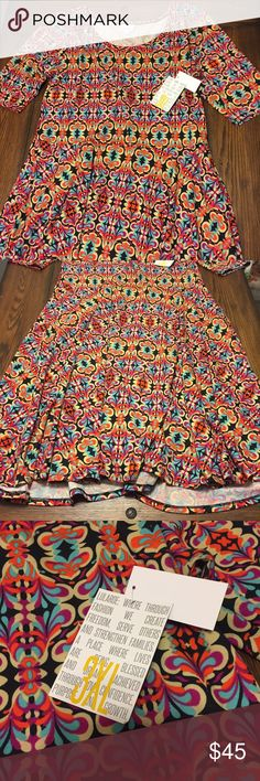 Lularoe Nicole Dress 3X Beautiful, vibrant print! Looks great with black tights, denim jacket, and black boots or booties! Only selling because it's a little too big for me! Brand new with tags attached! LuLaRoe Dresses