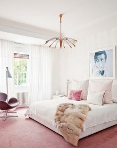 Inside a Groovy Pad Fit for a Queen// glamorous bedroom, feminine bedroom, midcentury modern lighting, black and white photography