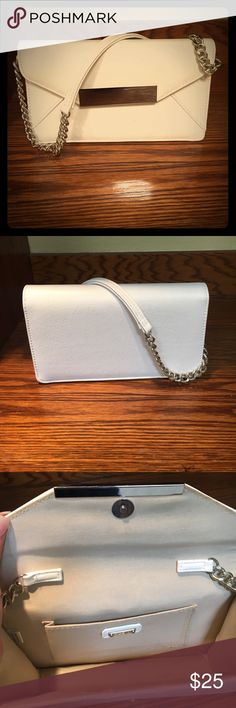 White Aldo clutch purse with silver chains This classy clutch is a perfect pair for that formal gown, and even those vintage jeans. Your essentials will be secure thanks to the magnetic snap closure, and silver chain panel A timeless piece that is necessary for every wardrobe . Has been worn a few times please refer to the pictures . No trades and payments through Poshmark Only Aldo Bags Clutches & Wristlets