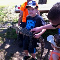 Hunter holding a four year old alligator.