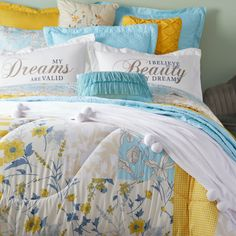 Add eye-catching appeal to your bed space with the Pippa bedding set. Made from a super-soft and breathable fabric to keep you cozy, this multi-dimensional bedding set is balanced out by its simple, yet impactful pillowcases with inspirational graphics. This decorative bedding set can be paired with the matching sheet set and pompom plush blanket to create a cozy resting spot in your master suite, guest bedroom or just about any other bedroom in your home. Pillowcases, Sheet Sets, Master Suite, Bedding Sets, Comforters, Plush, Cozy, Inspirational, Graphics