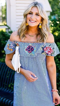 Step out with a simplistic yet springtastic ensemble. Office stripes get a floral with this embroidered design. Bloom on Stripes Embroidered Off-shoulder Dress featured by Audreymadstowe Blog