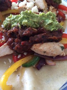 Marinated chicken fajitas with fresh guacamole and some roasted vegetable salsa leftover from when I made tacos carne asada.