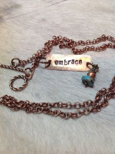 A personal favorite from my Etsy shop https://www.etsy.com/listing/213718362/embrace-stamped-copper-necklace-antiqued