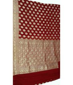 Maroon Banarasi Pure Georgette Saree-----------------------------Classy and appealing, this maroon coloured saree will certainly make you look elegant at any occasion.---- Sarees from Luxurionworld
