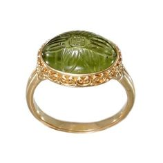carved peridot cabochon ring by Soul Biota