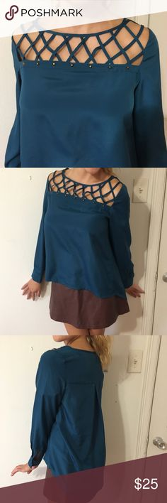 Studded Cutout Cage Neck Top Midnight blue cutout caged neck top with studs. Worn twice. In excellent condition. Purchased from Apricot Lane Boutique. Apricot Lane Tops Blouses