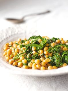 """Chickpeas With Rocket and Sherry: This is not quite a stir-fry, though I do cook it in my wok. The chickpeas get soused with the sherry and infused with cumin, and the rocket, or rather the tangle of green things that come in the packet called """"roquette salad"""" at my supermarket, wilt leggily in the pan."""