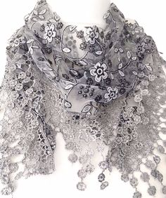 Grey floral vintage lace style triangle scarf with a little sprinkle of glitter and a tassel trim The scarf measures approx 65 inch 162 cm in length Sprinkle Of Glitter, Triangle Scarf, Lace Scarf, Vintage Lace, Vintage Style, Scarf Styles, White Women, Grey And White, Cooking Aprons