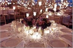 Branch centrepieces with candles are the bomb this is what I want!! With an orchid arrangement..