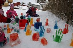 Freeze water and food coloring in gloves and buckets for outdoor decoration or activity.