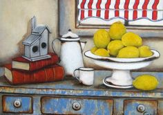 Art by Stella Bruwer white enamel cup. Footed bowl with lemons  and enamel  coffee pot stacked books on shabby blue table with drawers
