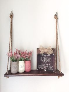Rustic handmade wood Hanging Shelf with Rope. Beautiful piece to display hand painted Mason Jars, flowers, etc. Wood: hand painted and distressed. Measures 24 long and 7.5 width Beautiful hand painted Mason Jars are also available for sale at our shop.