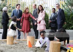 Catherine, Duchess of Cambridge, Prince William, Duke of Cambridge, Canadian Prime Minister Justin Trudeau and wife Sophie Trudeau watch children play in a sand pit during a visit to the Immigrant Services Society of British Columbia New Welcome Centre during their Royal Tour of Canada on September 25, 2016 in Vancouver, Canada.  (Photo by Andrew Milligan - Pool/Getty Images)