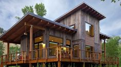 Exterior view of the home with wrap-around deck. Contemporary mountain house with Green materials. Recycled Wyoming snow fence wood siding, wood rainscreen, and shed roof. Shed Roof, House Roof, House Deck, Rustic Modern Cabin, Modern Cabins, Rustic Baby, Rustic Industrial, Small Modern Cabin, Contemporary Cabin