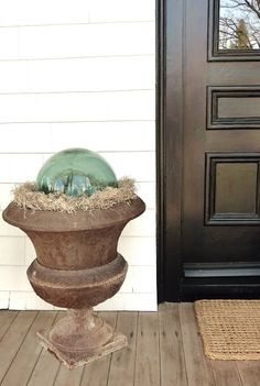 Glass float in an urn