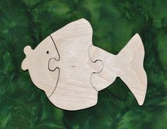 """Our puzzles are made from toy quality 1/2"""" Baltic birch plywood and are rubbed with AMF Naturals, an oil wax finish that is completely safe. Dimensions: 4.5"""" high, 6"""" long"""