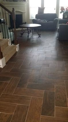 These are CERAMIC TILES from Home Depot that look like wood!  Perfect for a high traffic area that will see plenty of moisture (like a mudroom)!    Get them here: http://www.homedepot.com/p/Daltile-Parkwood-Brown-7-in-x-20-in-Ceramic-Floor-and-Wall-Tile-10-89-sq-ft-case-PD13720HD1P2/204417240
