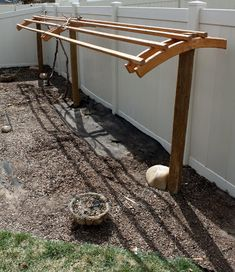 A solid wood trellis after the wire trellis sagged over time. A solid wood trellis after the wire tr