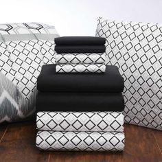 Black sheets and Black Lennox comforter. Find this cute sheet set and patterned comforter in any Value Pak on ocm.com! #dorm #ourcampusmarket #bedding