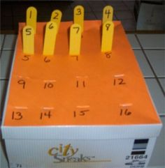 Popsicle sticks & a box...  Matching Numbers.  More ideas here, too.