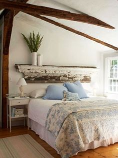 reclaimed wood headboard, exposed beams, natural light... all the things that I love in a room