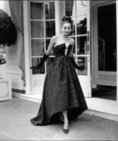 1958 ~ Christine Tidmarsh in silk moiré evening gown with deep décolletage by…