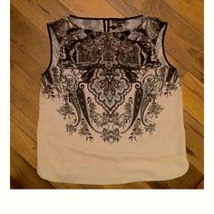 Adrianna Papell blouse Sleeveless blouse made of polyester material. Great for the office!!! Adrianna Papell Tops Blouses
