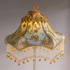 #1570 Antique floor lamp with flowers has been hand painted and holds a hand-dyed French Lovebirds silk lampshade. The shade is ombré dyed in sherbet