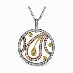 The distinctive circular design of this classic tri-tone pendant is highlighted .61 ctw round cut white diamonds and .15 round cut yellow diamond accents in an exquisite floral pattern. Print Page