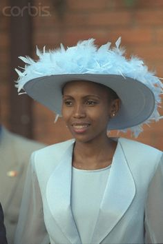 Queen Karabo Motsoeneng of Lesotho  royals  pale blue hat feathers  dress   coat africa