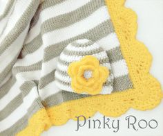 Baby Girl blanket and hat, Knit and crochet in stripes of Light Grey and white and yellow for the scalloped trim, the hat is embellish with a 3 layer