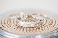 Mikkel Paige Photography photos of a small wedding at The Stockroom at 230 in downtown Raleigh, North Carolina. Detail image of the white gold diamond rings.